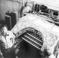 Neal Kissel with console of Wurlitzer Organ, Op. 870 (1924) shortly after its removal from the RKO Albee Theatre in Brooklyn, NY (photo courtesy Jeff Weiler)