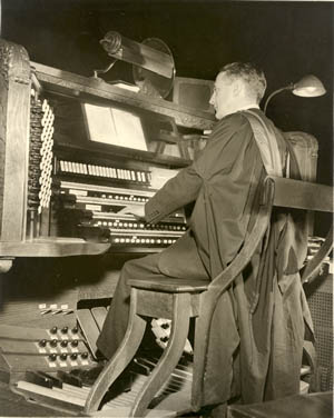 Alec Wyton at console of Aeolian-Skinner organ, Op. 150A (1951) in Cathedral of St. John the Divine - New York City