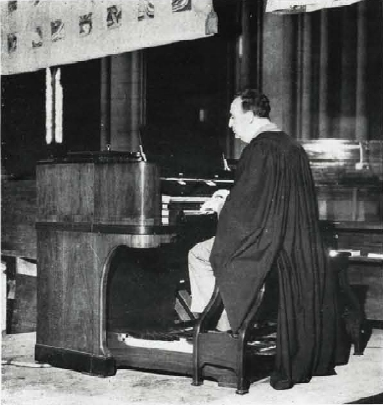 Norman Coke-Jephcott at the Everett Orgatron (1941) in the Cathedral Church of St. John the Divine - New York City